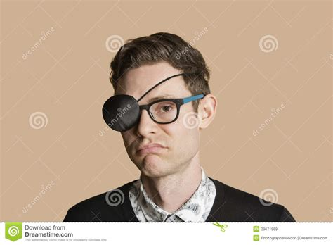 Portrait Of A Man Wearing Eye Patch On Glasses Over